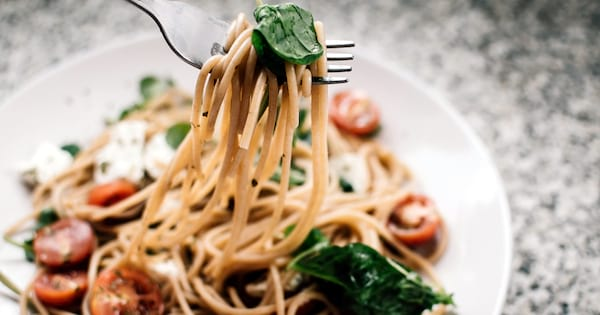 National Spaghetti Day Instagram Captions, closeup of a plate of spaghetti with a fork, food & drinks