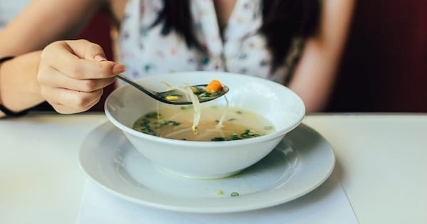 The Best Cheap and Delicious Soup Recipes, closeup of a bowl of soup and someone eating it, food & drinks