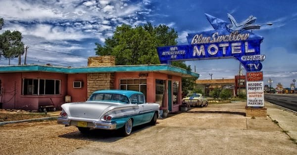 old fashioned car parked at motel in new mexico