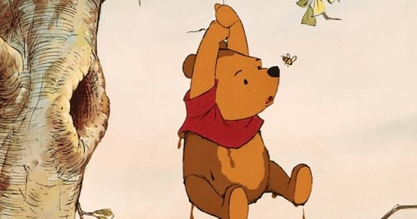 winnie the pooh hanging onto a tree, disney character