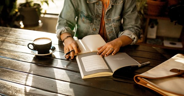 Incredible Mindfulness Journals, photo of a woman writing in a journal, books