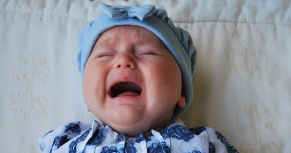 baby wearing blue crying, parenting