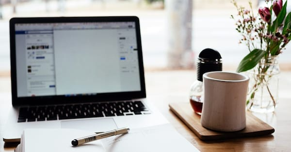 SMART Goals, image of a journal, coffee cup, a laptop, and a vase of flowers, career, home