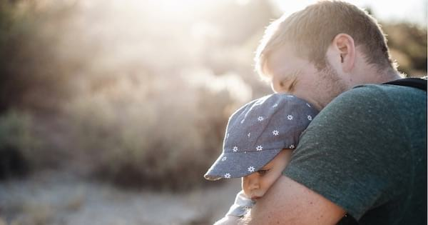 father holding baby outside, parenting