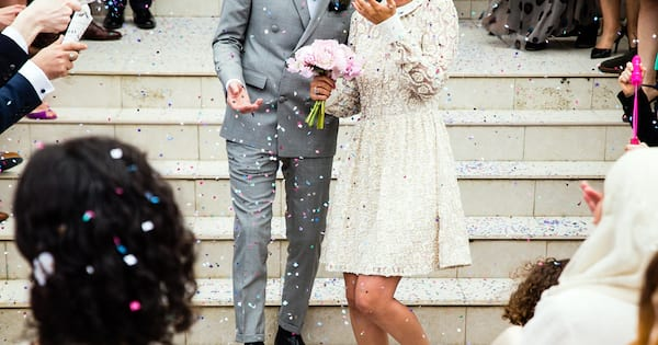 Courthouse Wedding Instagram Captions, photo of a bride and groom walking down the steps outside after getting married, relationships