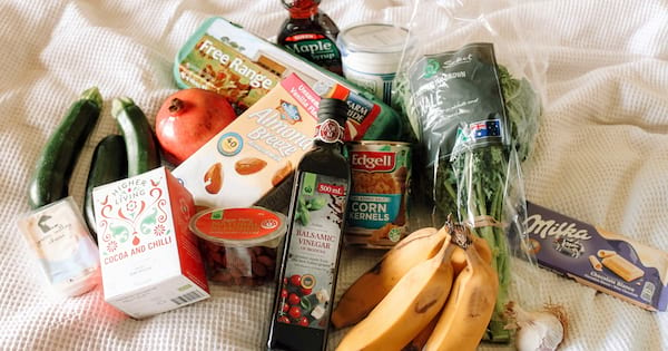 Best Goods To Have Stocked In Your Cupboard, image of assorted groceries lumped together on a table, money, food & drinks