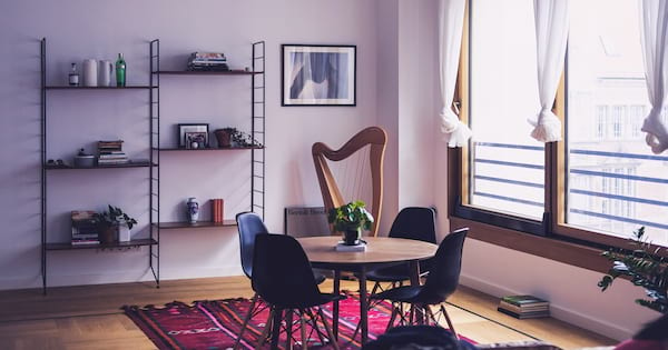 New Apartment Instagram Captions, a photo of an apartment featuring a table, bookshelf and window, home