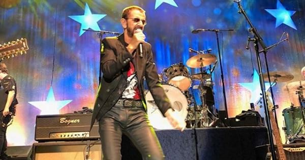 ringo star singing on stage, the Beatles