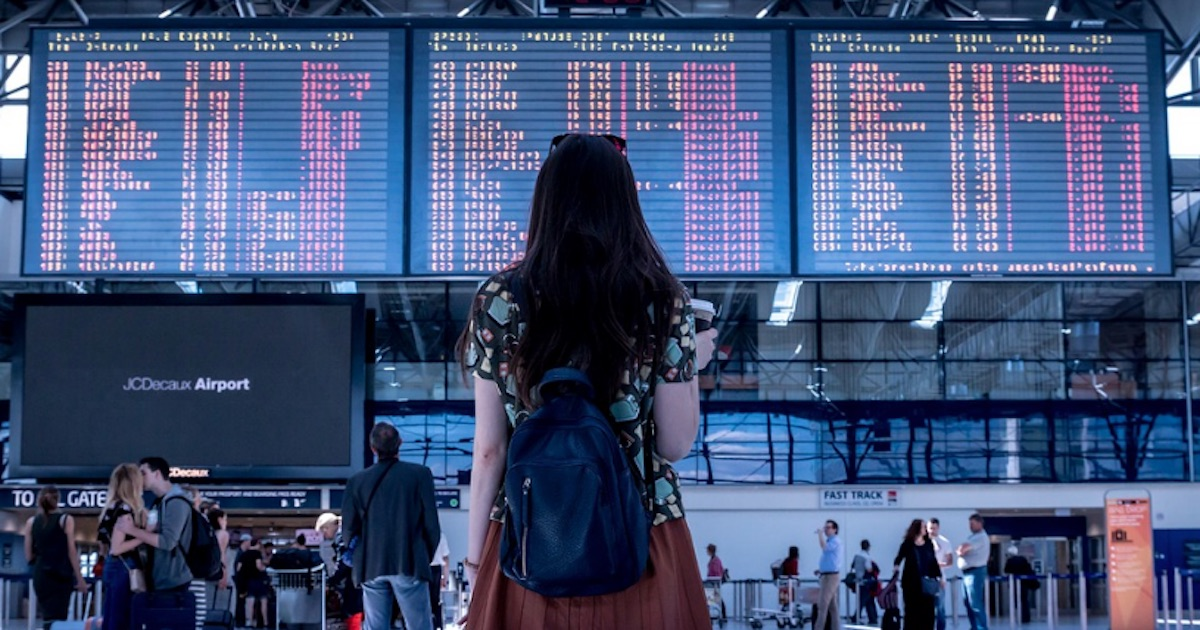 woman standing in airport traveling
