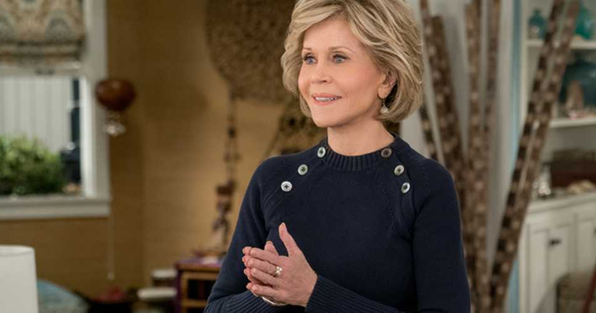 Jane Fonda holding her hands in a prayer position in an episode from Grace and Frankie