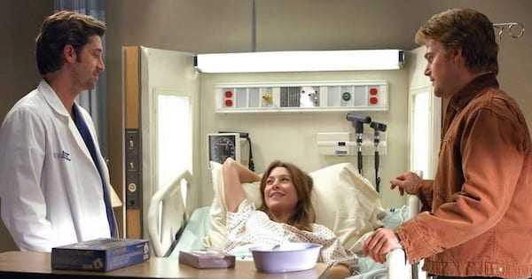 meredith in a hospital bed with finn and derek beside her, grey's anatomy