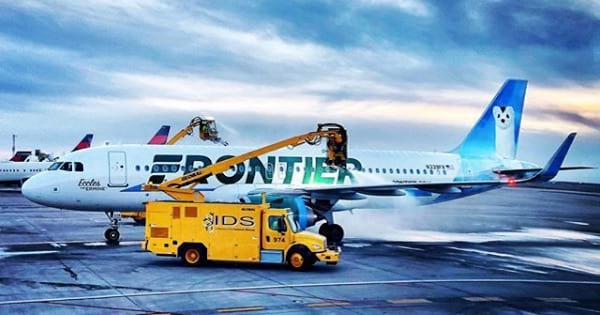 frontier airlines plane on tarmac, airline
