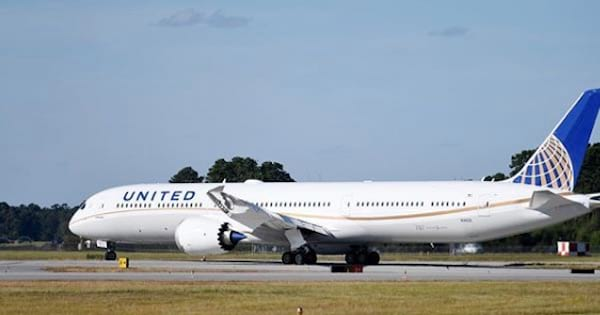 united plane sitting on tarmac, airline