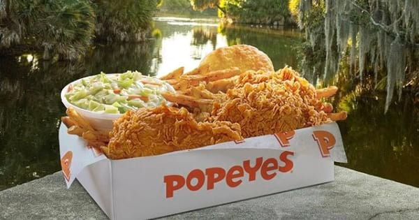 popeyes louisiana kitchen box with fried chicken, biscuits, and coleslaw, chicken food chain