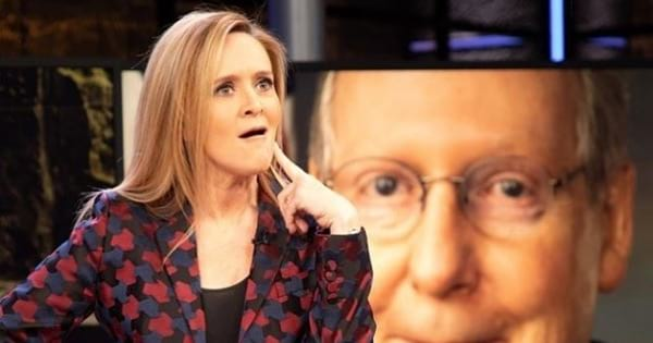 samantha bee standing up with hand on her face, late-night tv host