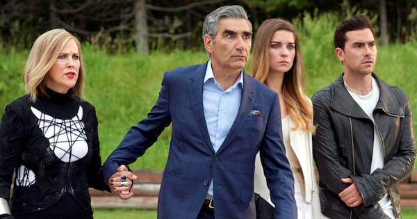 TV Shows You Won't Regret Watching, still from the show Schitt's Creek in which the Rose family stands close together, tv, pop culture