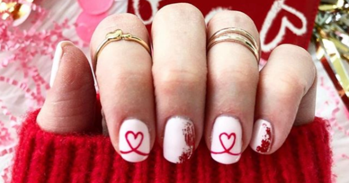 Girl showing off her Valentine's Day-themed nail art design