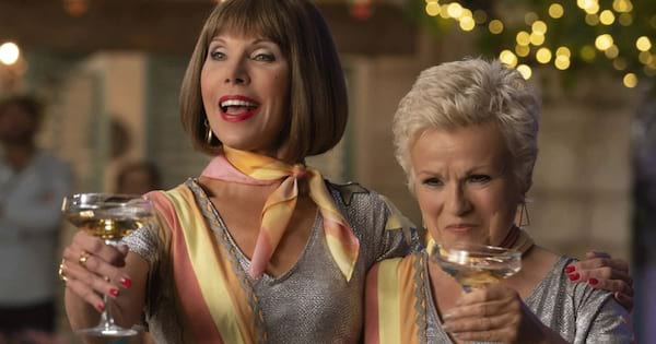 Tanya and Rosie cheersing in a scene from Mamma Mia! Here We Go Again