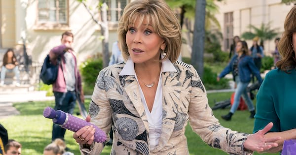Jane Fonda talking to students while holding a vibrator on Grace and Frankie