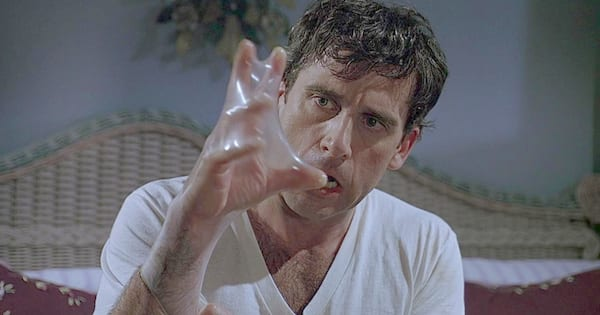 Steve Carell with a condom on his hand in a scene from The 40-Year-Old Virgin