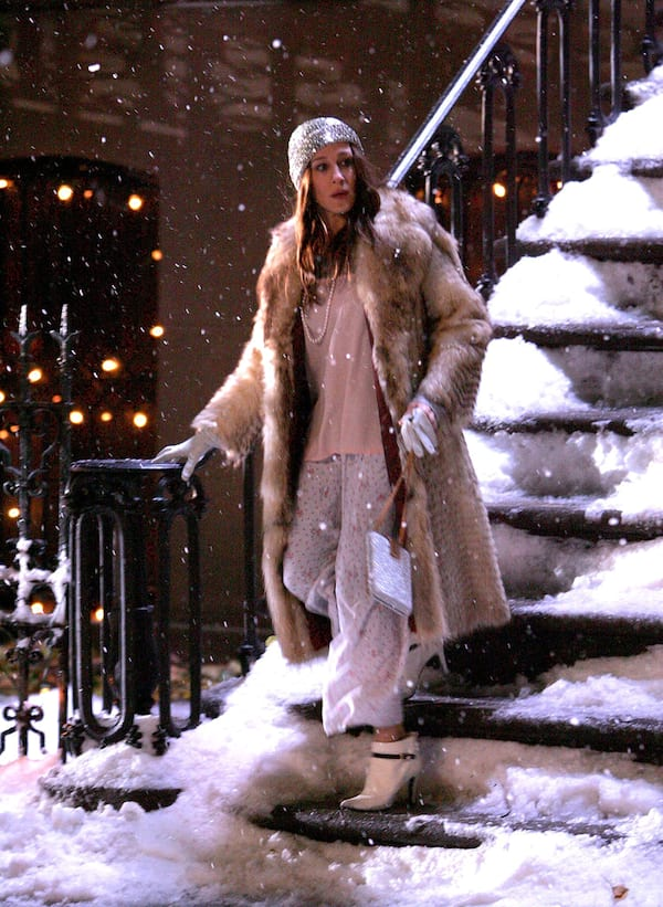 Carrie Bradshaw running out of her apartment into the snow wearing pajamas and a fur coat in Sex and the City
