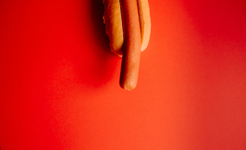 Hot dog on a red background