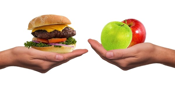 food, hands holding our hamburger and apple