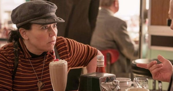 tv, susie myerson looking surprised with a milkshake sitting in front of her