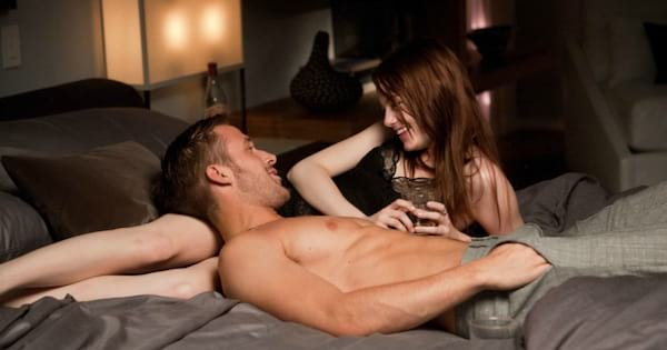 Ryan Gosling and Emma Stone laying in bead together in a scene from Crazy, stupid, love