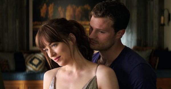 Ana and Christian getting cozy in a scene from Fifty Shades Freed