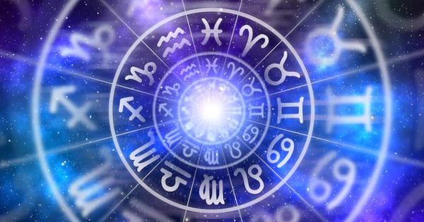 Astrological zodiac signs inside of horoscope circle on universe background