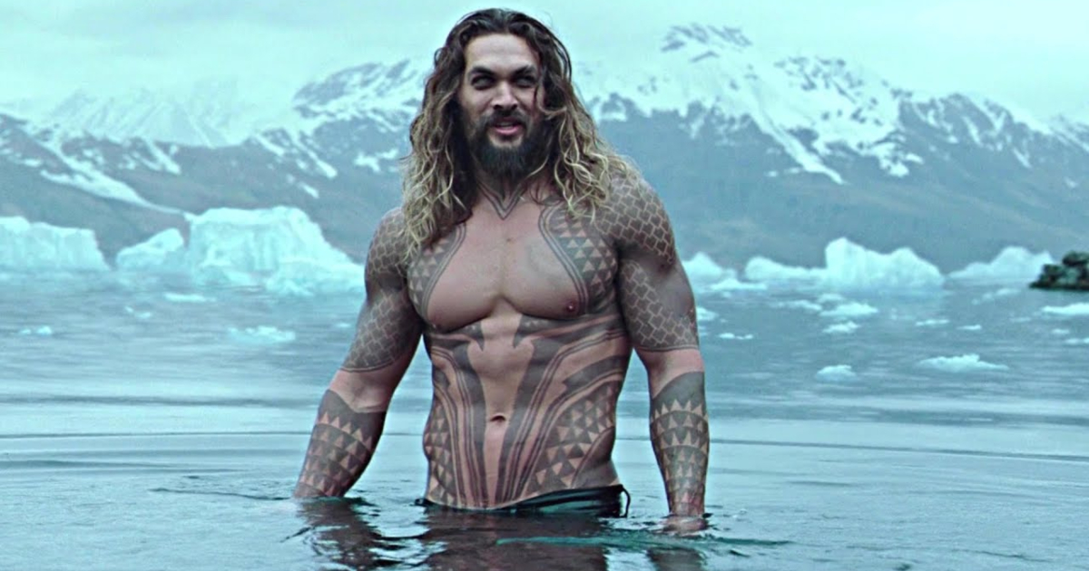 Jason Mamo shirtless in the water in a scene from Aquaman
