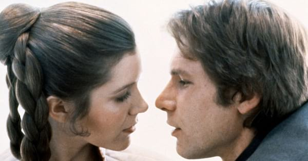 Princess Leia and Han Solo about to kiss in a scene from The Empire Strikes Back