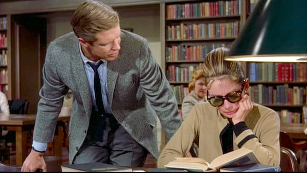 Audrey Hepburn reading a book with George Peppard in Breakfast at Tiffany's