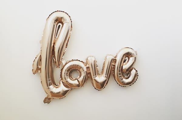 Gold balloon that says \love\