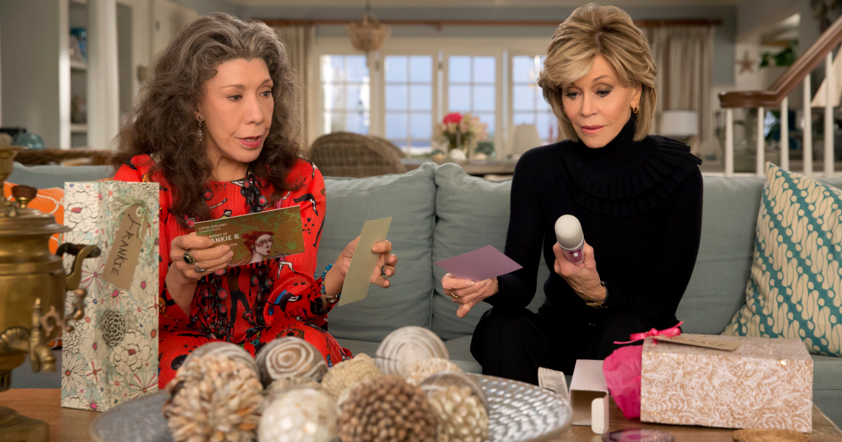 Grace and Frankie unwrapping sex toys that were gifted to them
