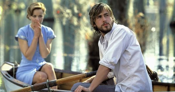 Noah and Allie riding in a boat on the lake in a scene from The Notebook