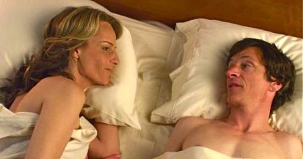 Helen Hunt laying in bed in The Sessions