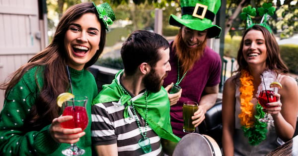 Friends celebrating St. Patrick's Day with drinks in a bar