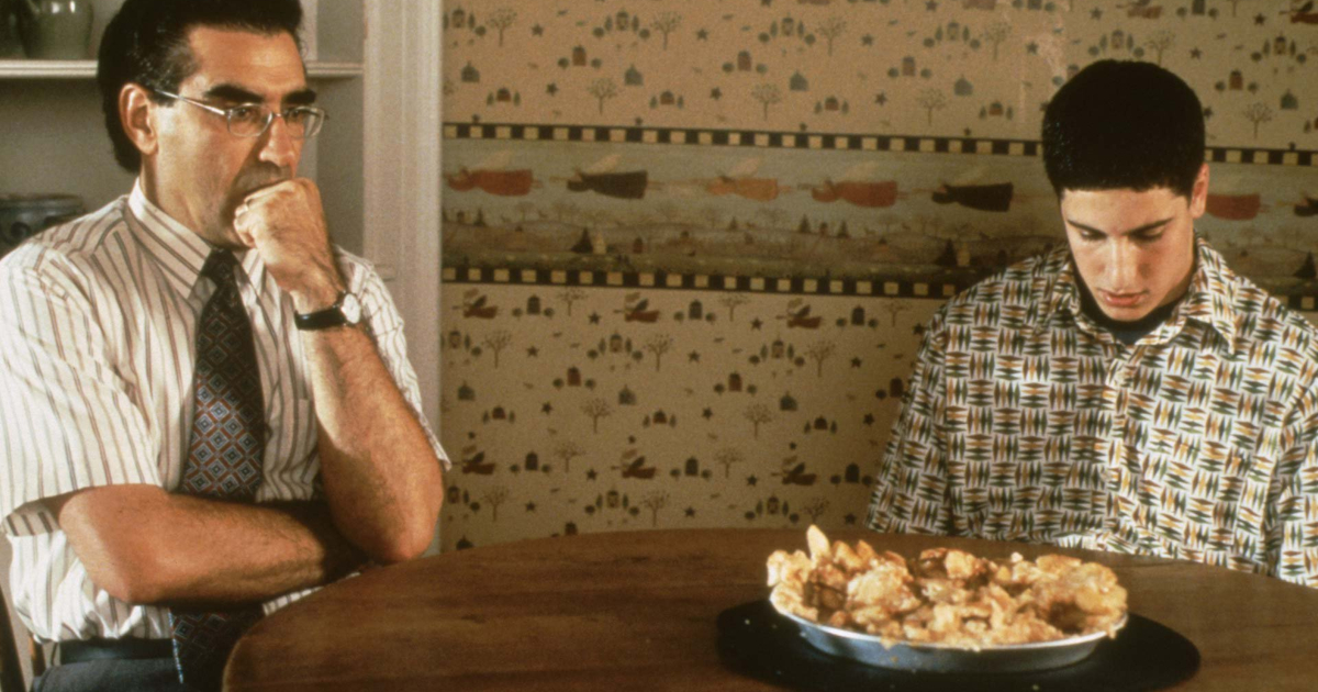 Jason Biggs and Eugene Levy looking at a destroyed apple pie in disgust during a scene from American Pie