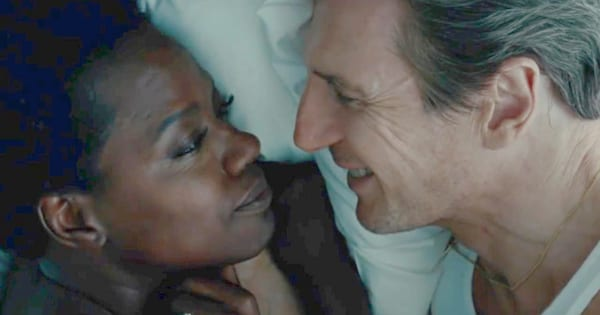 Viola Davis and Liam Neeson in bed together in the movie Widows