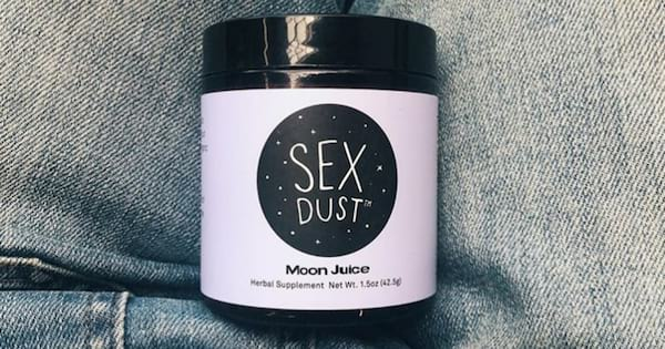 Sex Dust container resting in a woman's lap