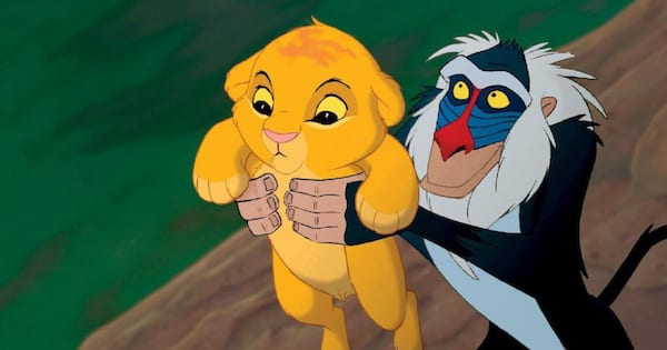 Rafiki holding up baby Simba on Pride Rock for all to see in the beginning of 'The Lion King'