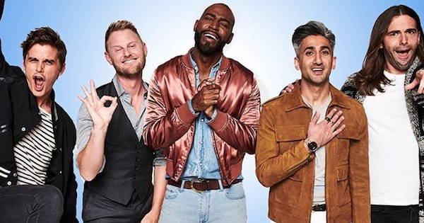 The cast of Queer Eye posing on a blue background making supportive faces at the camera
