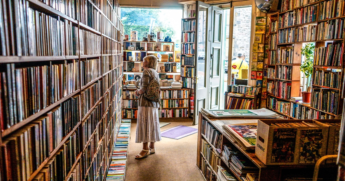 Bookstore Romance Day, a white woman looking at books in a bookstore, books, wdc-slideshow