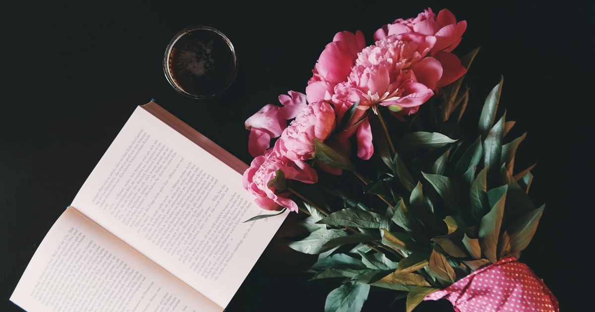 Bookstore Romance Day, image of an open book and a bouquet of pink flowers, books, wdc-slideshow