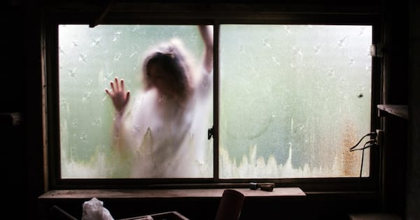 Poems About Depression, image of a white woman pressing her body on the other side of a window, books