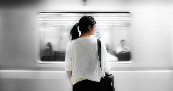 Poems About Depression, image of the back of a woman watching a train pass her, books