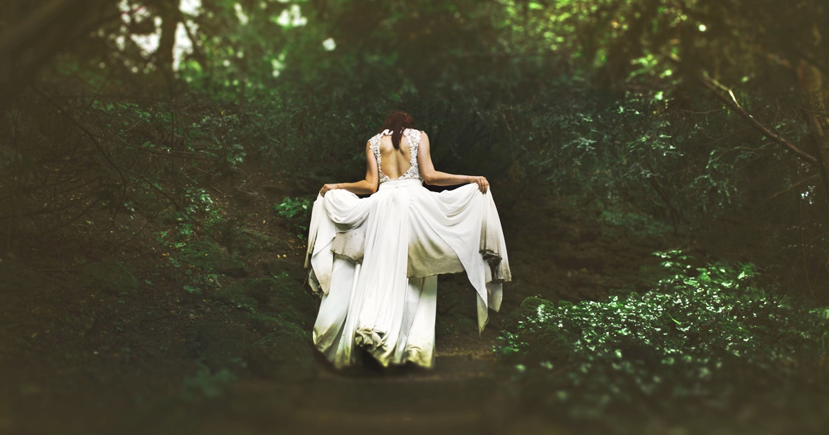 Romantic Retellings, a white woman in a long white dress runs through the woods, books