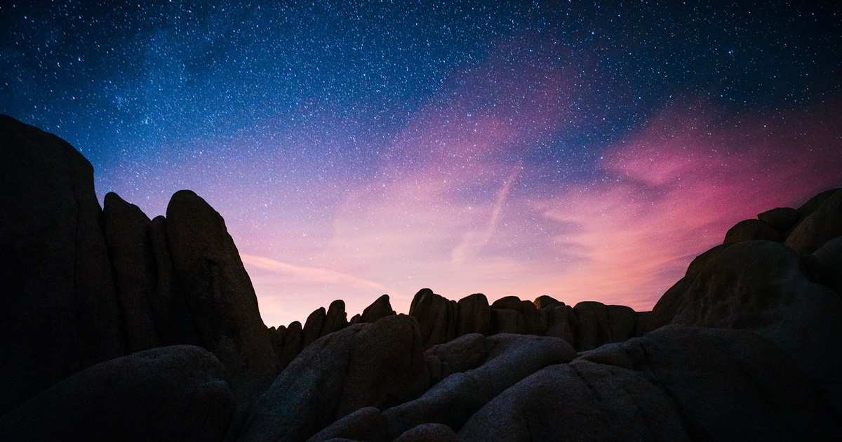 Ralph Waldo Emerson Quotes, image of the night sky behind rocks, books